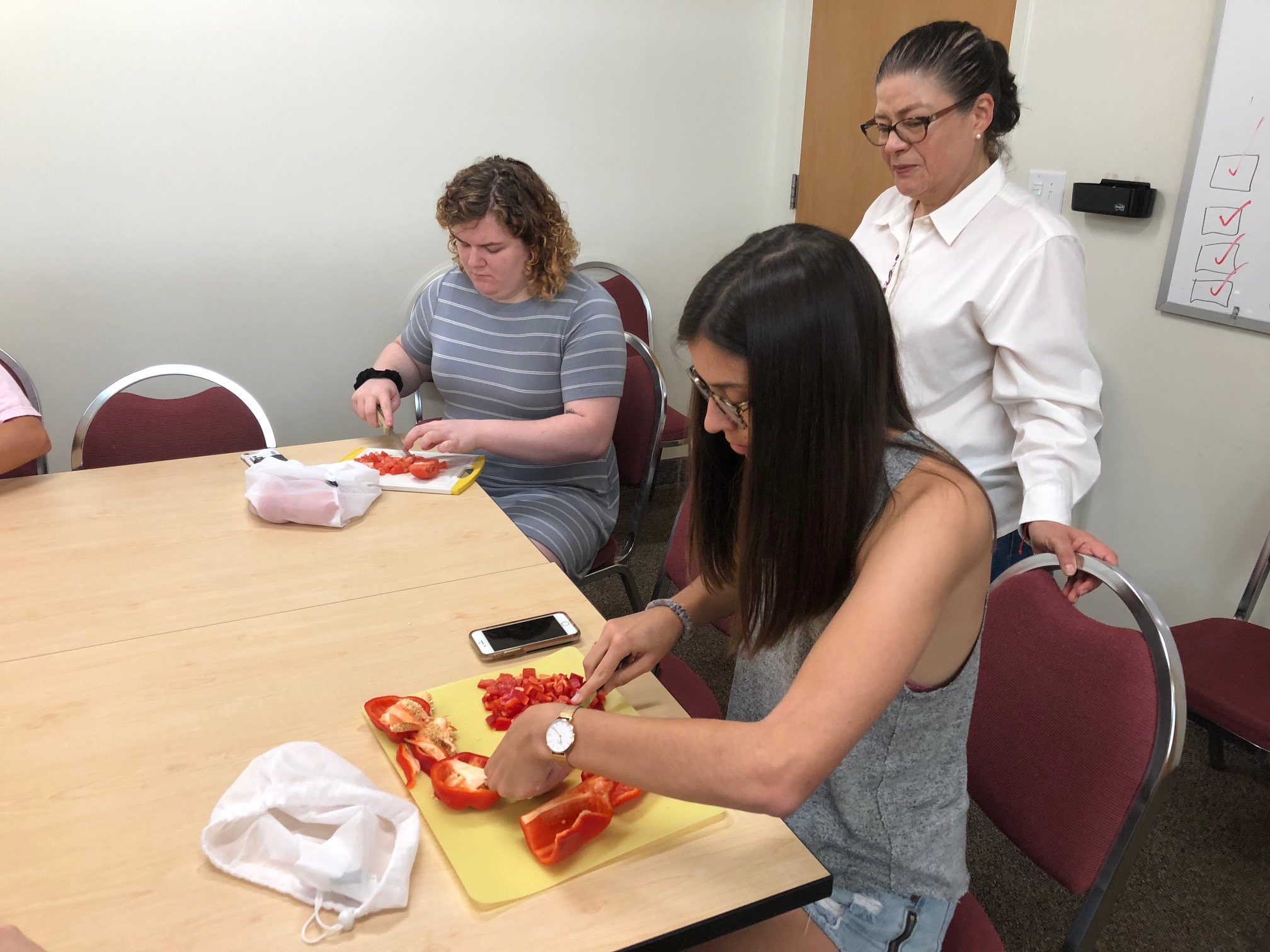 Students cutting vegetables at cooking workshop