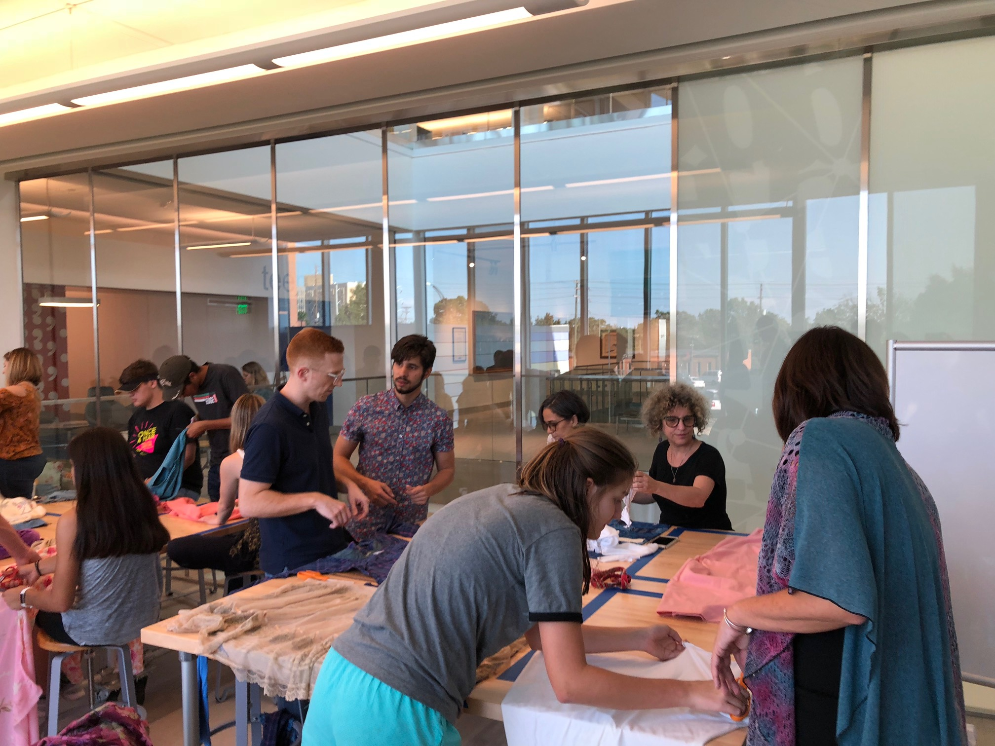 Students, faculty, staff and community sewing pillows